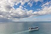 New Zealand, North Island, Mt. Manganui, elevated view of cruiseship and Tauranga Harbor.