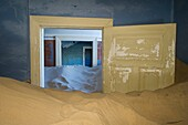 Kolmanskop, Southern Namibia, Africa. Old abandoned mining town's houses with sand.