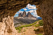 Three peaks of Lavaredo views from a cave, Bolzano Province, Trentino Alto Adige, Italy.