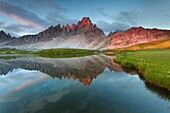 Monte Paterno, Dolomites, Italy. The mountain reflects onlaghi dei Piani, alpine lakes, at sunrise.