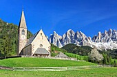 The Church of Ranui and the Odle group in the background. St. Magdalena Funes Valley Dolomites South Tyrol Italy Europe.