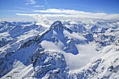 Aerial view of Peak Ferrè covered with snow Spluga Valley Chiavenna Valtellina Lombardy Italy Europe.