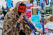 Bandari woman, Iran.