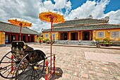 Traditional rickshaw carriage at Truong Sanh Palace. Imperial City (The Citadel), Hue, Vietnam.