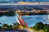 Truong Tien Bridge (designed by Gustave Eiffel) illuminated at dusk. Hue, Vietnam.
