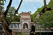 View of The Precious Wall (Buu Thanh) and entrance gate to the Royal Crypt (Huyen Cung). Tomb of Tu Duc, Hue, Vietnam.