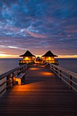 Dusk over the pier and Gulf of Mexico from Naples, Florida, USA.