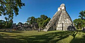 "Temple I, or Temple of the Great Jaguar, is a funerary pyramid dedicated to Jasaw Chan K'awil, who was entombed in the structure in AD 734. The pyramid was completed around 740â. ""750 and rises 47 meters or154 feet high. Tikal National Park, Guatemala, is"