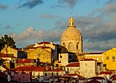 Portugal, Lisbon, Miradouro das Portas do Sol, View over Alfama Neighbourhood towards the National Pantheon at sunset.