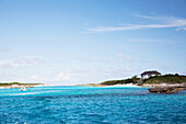 EXUMA, Bahamas. A view of the water and a house at Musha Cay.