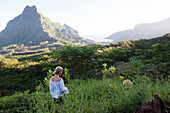 FRENCH POLYNESIA, Moorea. Laurel and her kds going for a morning hike.