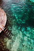 JAMAICA, Oracabessa. Goldeneye Hotel and Resort. A deck that has stairs leading to the water.