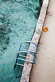 JAMAICA, Oracabessa. Goldeneye Hotel and Resort. Steps to the lagoon at the resort.