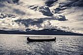 USA, Alaska, Homer, China Poot Bay, Kachemak Bay, a large canoe resting in the waters off of Kachemak Bay Wilderness Lodge