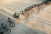 BELIZE, Caye Caulker, bikes lined up at the Lazy Lizard Bar