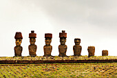 EASTER ISLAND, CHILE, Isla de Pascua, Rapa Nui, the Ahu Nao-Nao Moai statues on the Anakena white coral beach in Rapa Nui National Park