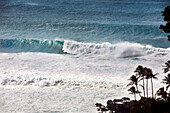 HAWAII, Oahu, North Shore, waves crashing at Waimea Bay on the North Shore