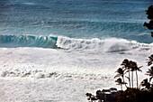 HAWAII, Oahu, North Shore, waves crashing at Waimea Bay on the North Shore