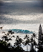 HAWAII, Oahu, North Shore, surfers in the water at Waimea Bay