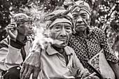 INDONESIA, Flores, 100 year old elder Wilhelmus Etu has a smoke with his friends, in Kampung Tutubhada village in Rendu