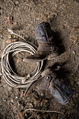 USA, Oregon, Enterprise, the boots and lasso of Cowboy Cody Ross at the Snyder Ranch in North East Oregon between Enterprise and Joseph