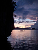 PHILIPPINES, Palawan, El Nido, a sunset view at Lagen Island resort in Bacuit Bay in the South China Sea