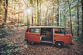 VW Bus in the forest in autumn, Aalen, Ostalbkreis, Baden-Württemberg, germany, europe.