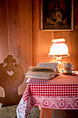 book, cup of tea, wooden room, traditional decoration, winterly interior, warmness, the Alps, South Tyrol, Trentino, Alto Adige, Italy, Europe