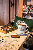 cup of tea, wooden room, traditional decoration, winterly interior, warmness, the Alps, South Tyrol, Trentino, Alto Adige, Italy, Europe