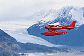 Air-To-Air View Of A Cessna 206 Stationair Floatplane Next To The Kenai Mountains, Kachemak Bay State Park, Southcentral Alaska, USA