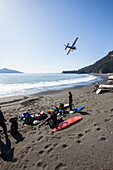 Cessna 206 Taking Off After Having Dropped Off Surfers And Gear, Kenai Peninsula Outer Coast, Southcentral Alaska, USA