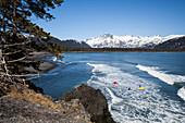 Surfers Along The Kenai Peninsula Outer Coast, Southcentral Alaska, USA