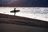 Surfer On The Shores Of Kachemak Bay, Homer Spit, Southcentral Alaska, USA