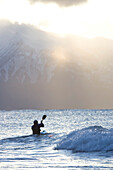 Kayaker In Kachemak Bay Near Homer, Southcentral Alaska, USA