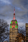 Empire State Building In Christmas Colours; New York City, New York, United States Of America