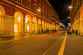 Red Light Trail Of Train Lights Down A Street; Nice, Cote D'azur, France