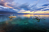 Sunset Over The Ocean With Pump Boats; Moalboal, Cebu, Central Visayas, Philippines