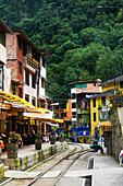 End Of The Train Tracks In Downtown Aquas Calientes, Gateway To Machu Picchu; Aguas Calientes, Cuzco, Peru