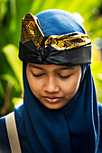 A Young Balinese Woman Poses At A Hindu Ceremony; Bali, Indonesia