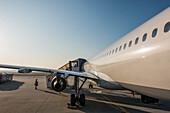 An Airplane Loading Passengers On The Tarmac At Frankfurt Airport; Frankfurt, Germany
