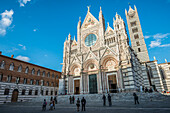 Front Facade Of The Ancient White And Red Marble Siena Cathedral; Siena, Italy