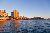 Skyline view of Waikiki Beach and Diamond Head Crater viewed from the ocean; Honolulu, Oahu, Hawaii, United States of America