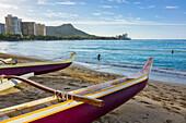 Outrigger canoes, Waikiki and Diamond Head on the island of Oahu; Honolulu, Oahu, Hawaii, United States of America