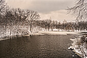 The Lake Partially Frozen In A Snowstorm In Central Park; New York City, New York, United States Of America