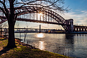 Hell Gate And Rfk Triboro Bridges At Sunset From Ralph Demarco Park; Queens, New York, United States Of America