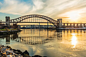 Hell Gate And Rfk Triboro Bridges At Sunset, Ralph Demarco Park; Queens, New York, United States Of America