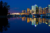 Reflection Of Vancouver's Skyline In The Evening; Vancouver, British Columbia, Canada