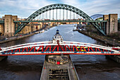 Three of the seven bridges across the river Tyne joining Newcastle upon Tyne and Gateshead, Swing Bridge (1876), the Tyne Bridge (1928) and the Gateshead Millennium Tyne and Wear, England