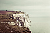 Rugged white cliffs along the coastline; Dover, England