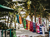 Clothing hanging on display for sale at an outdoor market; Cancun, Mexico